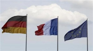 Flags of Germany, France and the European Union flutter in the wind before the meeting of new French President Hollande and German Chancellor Merkel in Berlin
