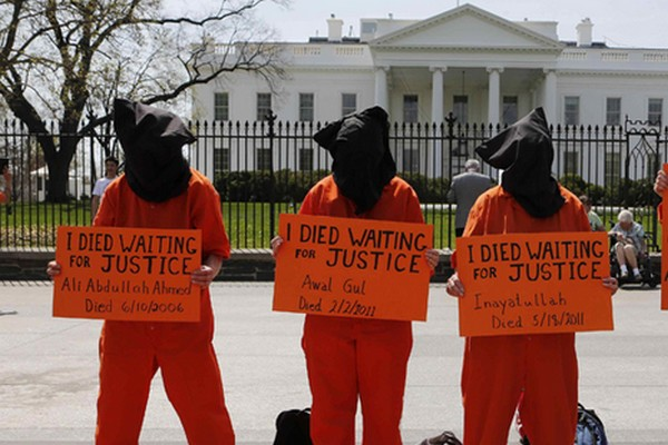 Activists rally for U.S. President Barack Obama to close down Guantanamo Bay prison while in Washington