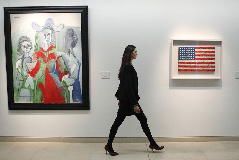 File-photo-of-Laura-Vere-Hodge-of-Christies-walking-along-a-gallery-containing-Picassos-Femme-et-Fillettes