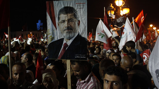 Supporters of the Islamist Ennahda movement hold a portrait of ousted Egyptian President Morsi during a demonstration in Tunis