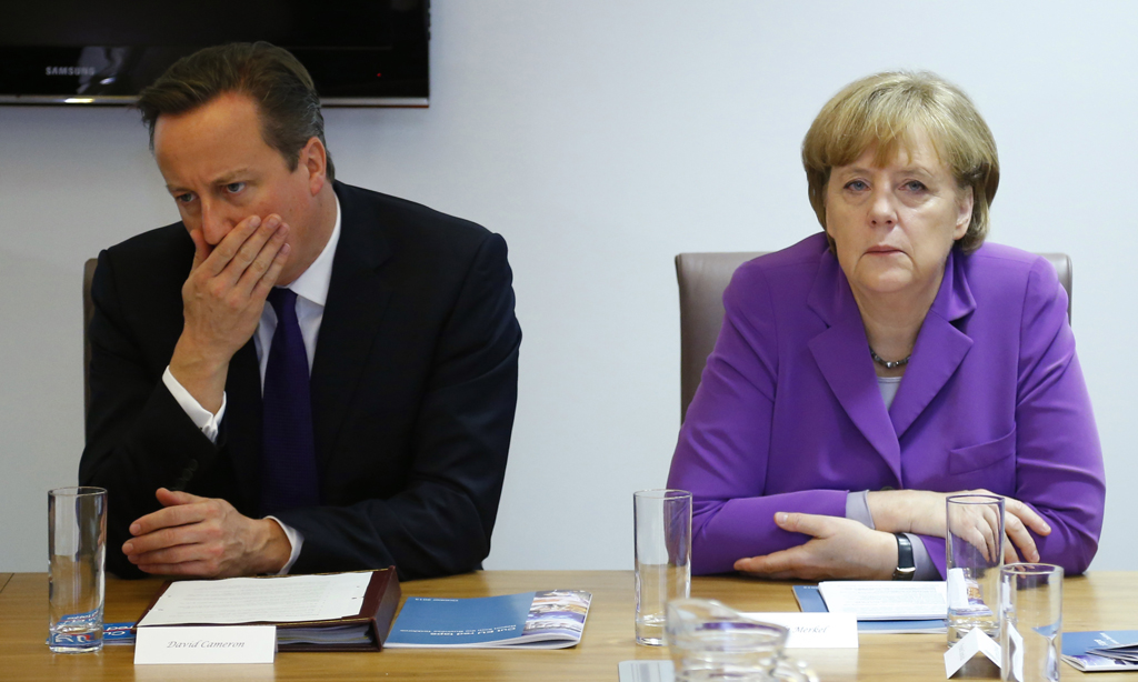 Britain's PM Cameron and Germany's Chancellor Merkel attend a meeting for a business task force in Brussels