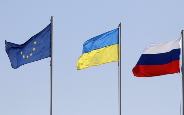 Flags of the European Union, Ukraine and Russia fly during the arrivals of leaders and delegations at an airport outside Minsk