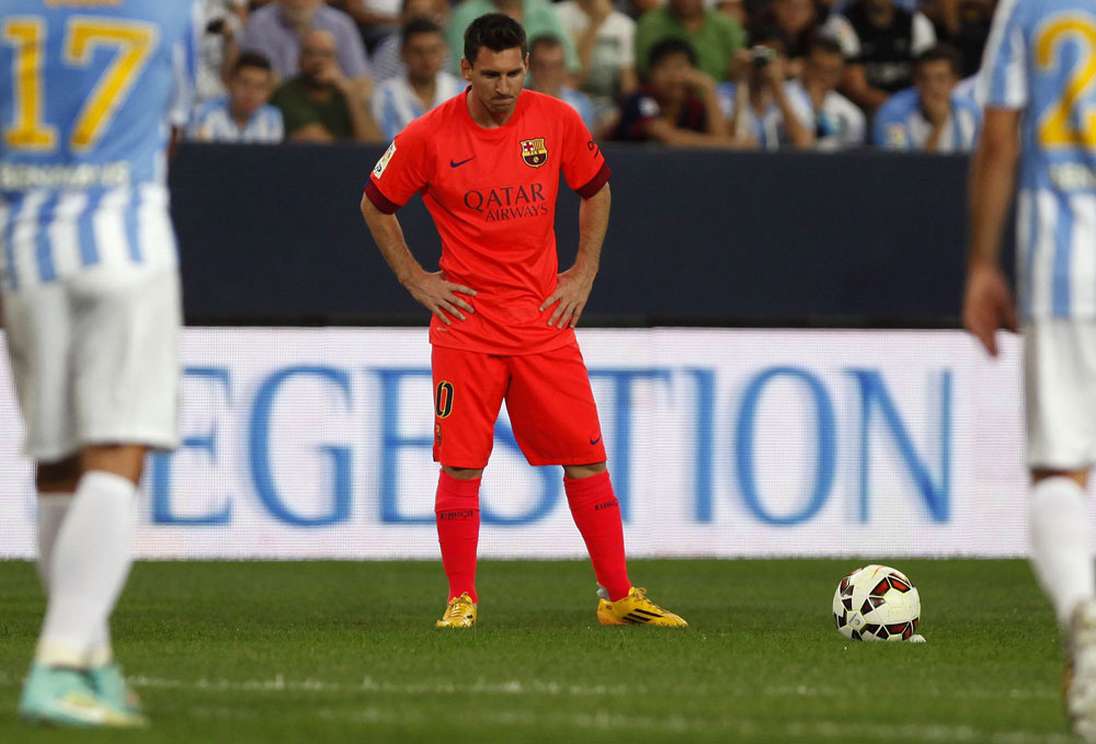 Barcelona's Messi prepares to kick a ball during their Spanish first division soccer match against Malaga in Malaga