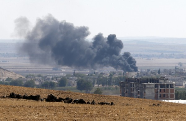Smoke rises from the Syrian town of Kobani, as seen from near the Mursitpinar border crossing on the Turkish-Syrian border in the southeastern town of Suruc