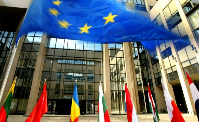 The flag of the European Union (top) stands at the entrance of  European council