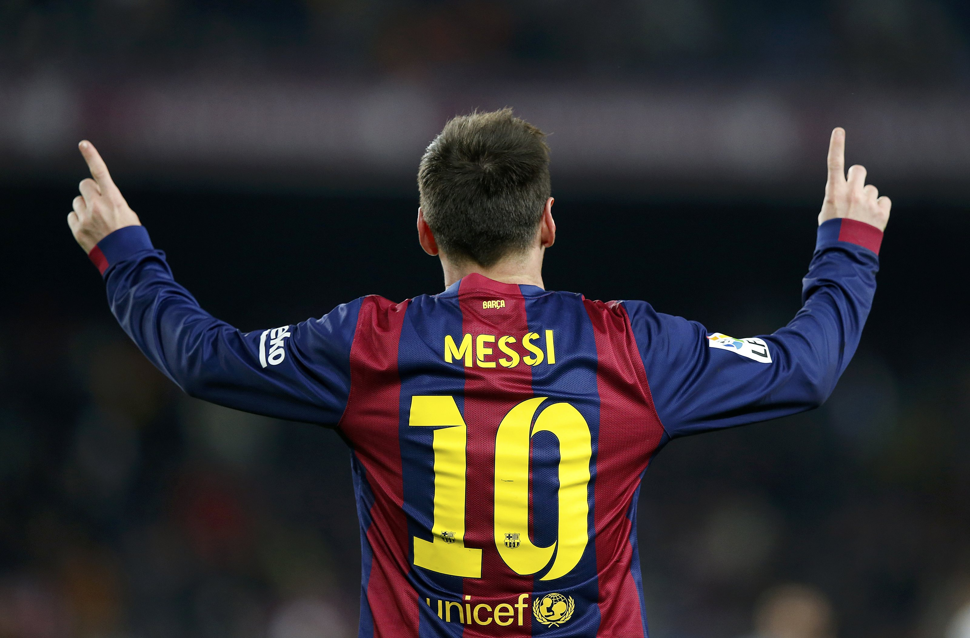 Barcelona's Lionel Messi celebrates after scoring a goal during their King's Cup quarter-final first leg soccer match in Barcelona