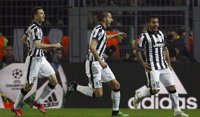 Tevez of Juventus celebrates his goal against Borussia Dortmund with team mates during their Champions League round of 16 second leg soccer match in Dortmund