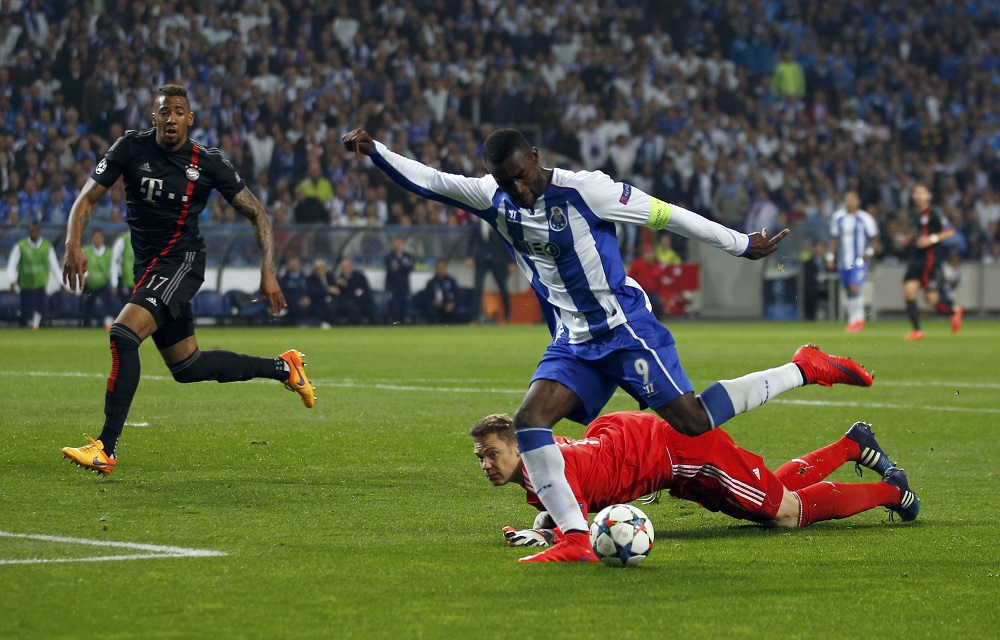Porto's Martinez scores his goal past Bayern Munich's goalkeeper Neuer and Boateng during their Champions League quarterfinal first leg soccer match in Porto