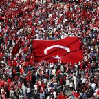 Supporters of various political parties gather in Istanbul's Taksim Square and wave Turkey's national flags before the Republic and Democracy Rally organised by main opposition Republican People's Party (CHP), Turkey, July 24, 2016.   REUTERS/Baz Ratner