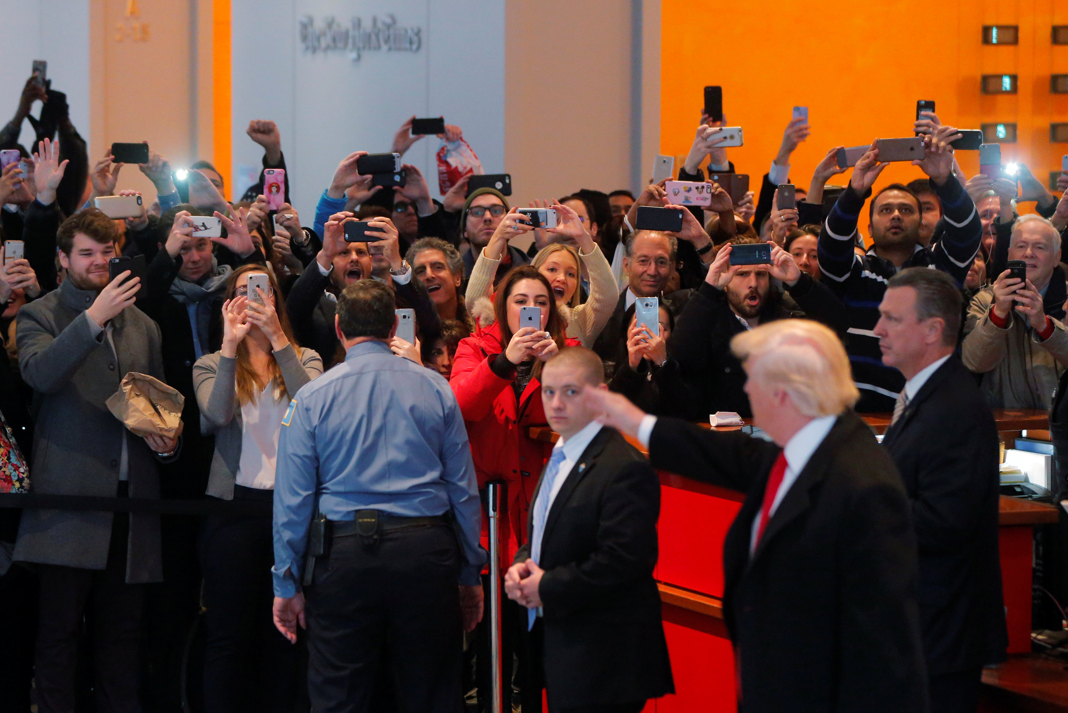 A gathered crowd reacts to U.S. President elect Donald Trump in the lobby of the New York Times building after a meeting in New York, U.S., November 22, 2016.  REUTERS/Lucas Jackson