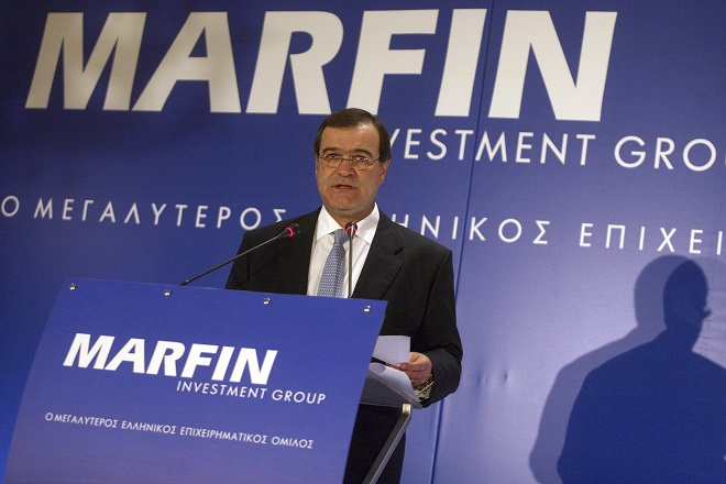 Marfin Investment Group (MIG) Chairman Andreas Vgenopoulos addresses journalists during news a conference in Athens, June 22, 2009. As Greeks head back to the polls in an election that may help to decide whether they stay in Europe's common currency, and as Cypriot politicians move closer to asking for an international bailout - perhaps as early as this week - the story of Vgenopoulos and Marfin helps explain how Greece and Cyprus got here. Picture taken June 22, 2009. To match Special Report GREECE/MARFIN    REUTERS/Icon (GREECE - Tags: BUSINESS) - RTR33J6J